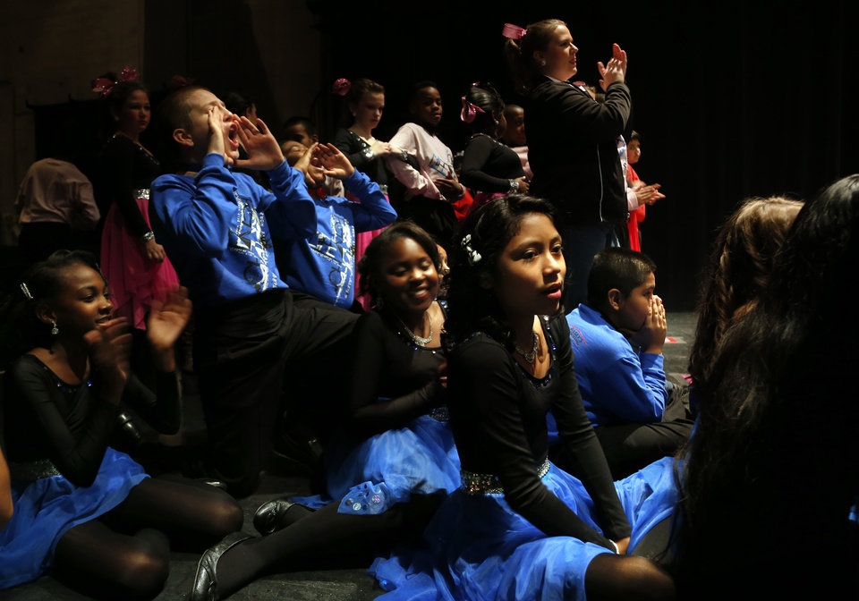 Photo -  Students from Britton Elementary cheer on their team during the LifeChange Ballroom competition at the Rose State Performing Arts Theatre in Midwest City. Photo by Sarah Phipps, The Oklahoman   Sarah PHIpps -  Sarah Phipps