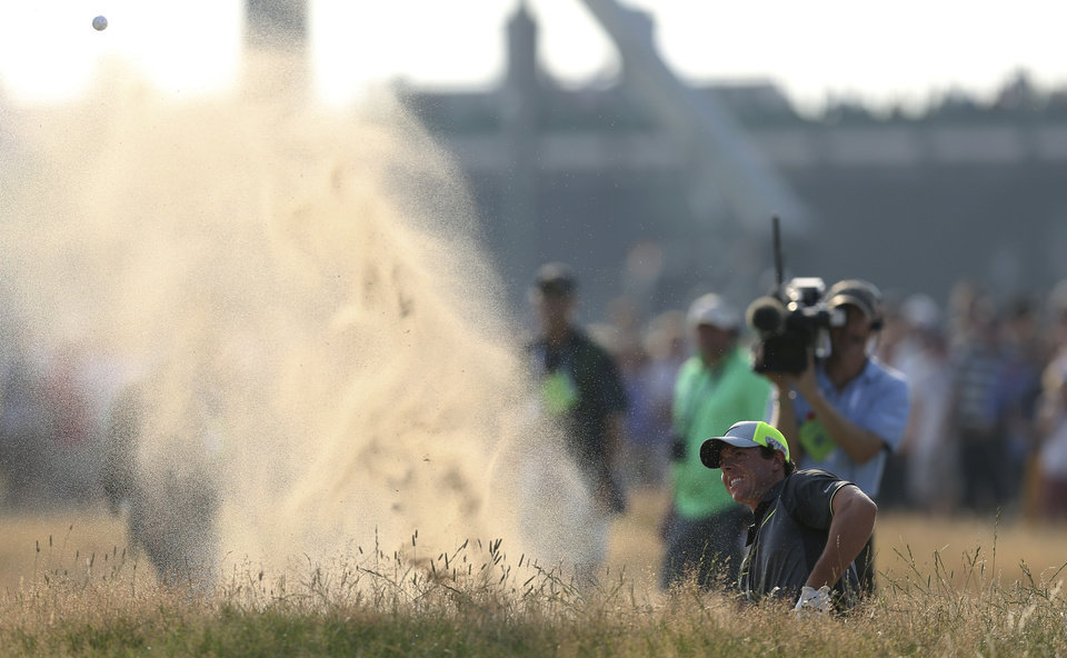 Photo - Rory McIlroy of Northern Ireland plays a shot out of a bunker on the 16th hole during the second day of the British Open Golf championship at the Royal Liverpool golf club, Hoylake, England, Friday July 18, 2014. (AP Photo/Scott Heppell)