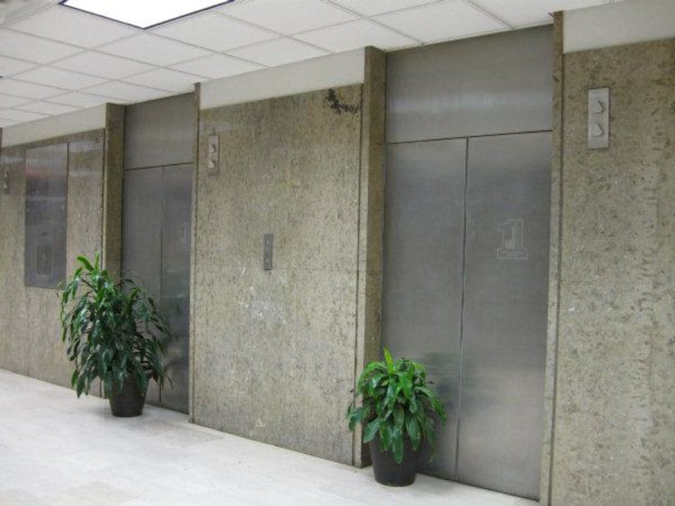 Plants block two of six elevators serving First National Center's east tower. The elevator shafts were replaced with heating and cooling connections to downtown's Trigen plant. Photo by Steve Lackmeyer, The Oklahoman