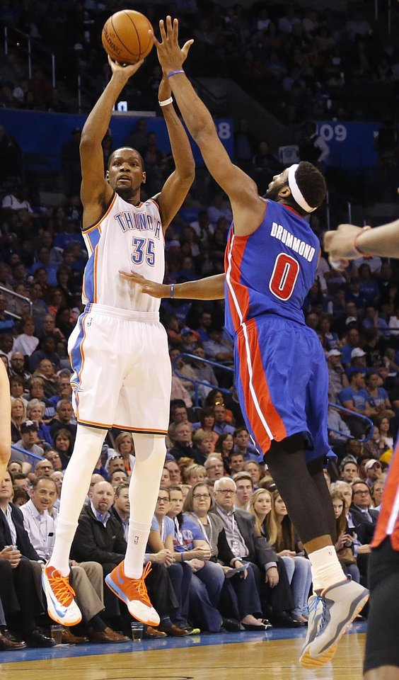 Photo - Oklahoma City's Kevin Durant (35) shoots over Detroit's Andre Drummond (0) during the NBA basketball game between the Oklahoma City Thuder and the Detroit Pistons at Chesapeake Energy Arena in Oklahoma City, Okla. on Wednesday, April 16, 2014.  Photo by Chris Landsberger, The Oklahoman