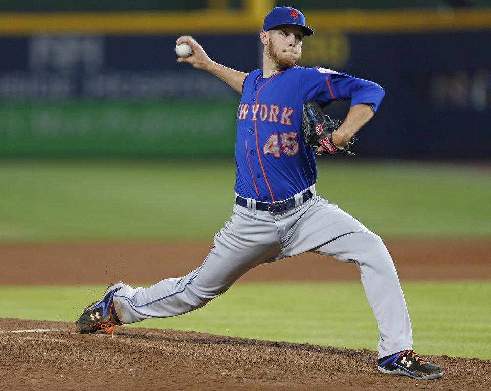 Photo - New York Mets starting pitcher Zack Wheeler (45) works in the fourth inning of a baseball game against the Atlanta Braves in Atlanta, Monday, June 30, 2014. (AP Photo/John Bazemore)