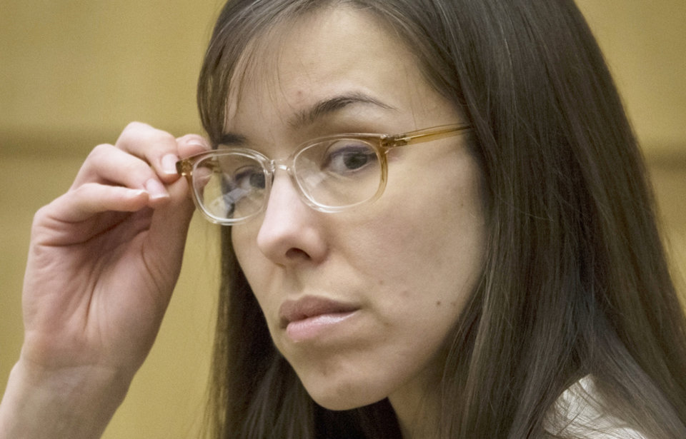 Photo - FILE - In this May 1, 2013 file photo, defendant Jodi Arias sits in the courtroom during her trial at Maricopa County Superior Court in Phoenix.  It has become a real-life soap opera for people around the world and dozens of fanatics who camp out on a Phoenix sidewalk to get into the show. The star is none other than a small-town waitress who killed her lover. Jodi Arias has been on trial since January, and her case has developed an enormous following with its tales of sex, violence and betrayal. (AP Photo/The Arizona Republic, Mark Henle, Pool, File)