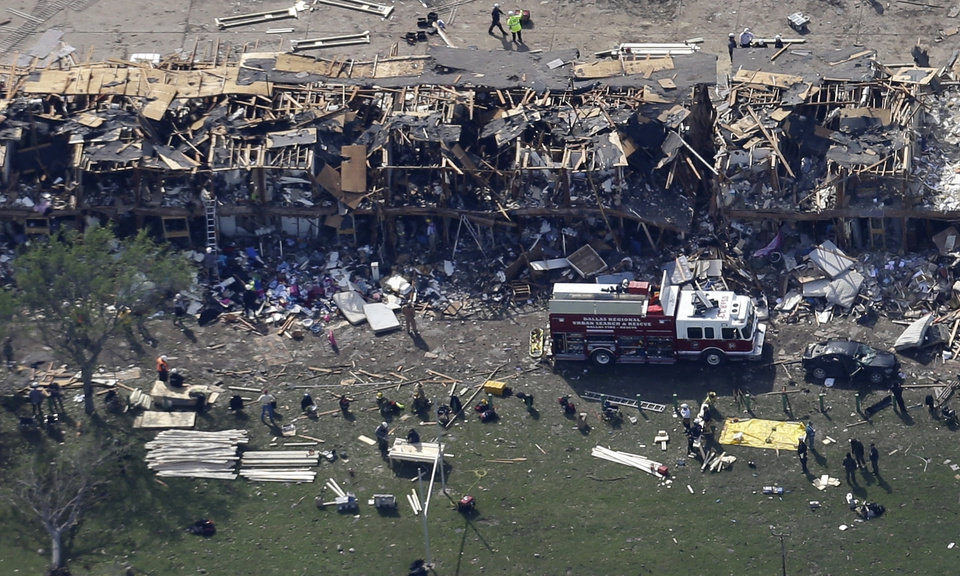 A Dallas Regional Urban Search and Rescue Truck sits parked by a destroyed apartment complex with emergency responders working the scene after it was destroyed by an explosion at a nearby fertilizer plant in West, Texas, Thursday, April 18, 2013. A massive explosion at the West Fertilizer Co. killed as many as 15 people and injured more than 160, officials said overnight. The explosion that struck around 8 p.m. Wednesday, sent flames shooting into the night sky and rained burning embers and debris down on shocked and frightened residents. (AP Photo/Tony Gutierrez)