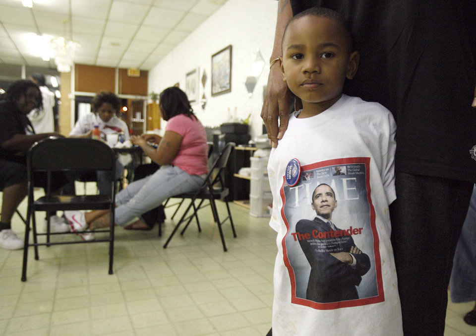 Photo - Brandon Johnson, 4, of Spencer, Okla., shows his support for Barack Obama at a watch party at the Images of Hair and Nails  salon Tuesday, Nov. 4, 2008, in Oklahoma City. PHOTO BY SARAH PHIPPS, THE OKLAHOMAN.