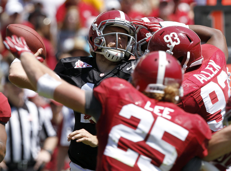 Photo - Alabama quarterback Alec Morris (11) is sacked by Jonathan Allen (93) and others during the A-Day NCAA college football spring game Saturday, April 19, 2014, in Tuscaloosa, Ala. (AP Photo/Butch Dill)