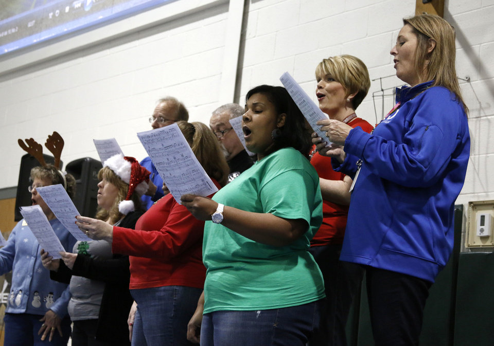Photo - Members of the Ida Freeman Elementary School faculty choir sing during Winterfest on Friday.  Photo by Paul Hellstern, The Oklahoman  PAUL HELLSTERN - Oklahoman