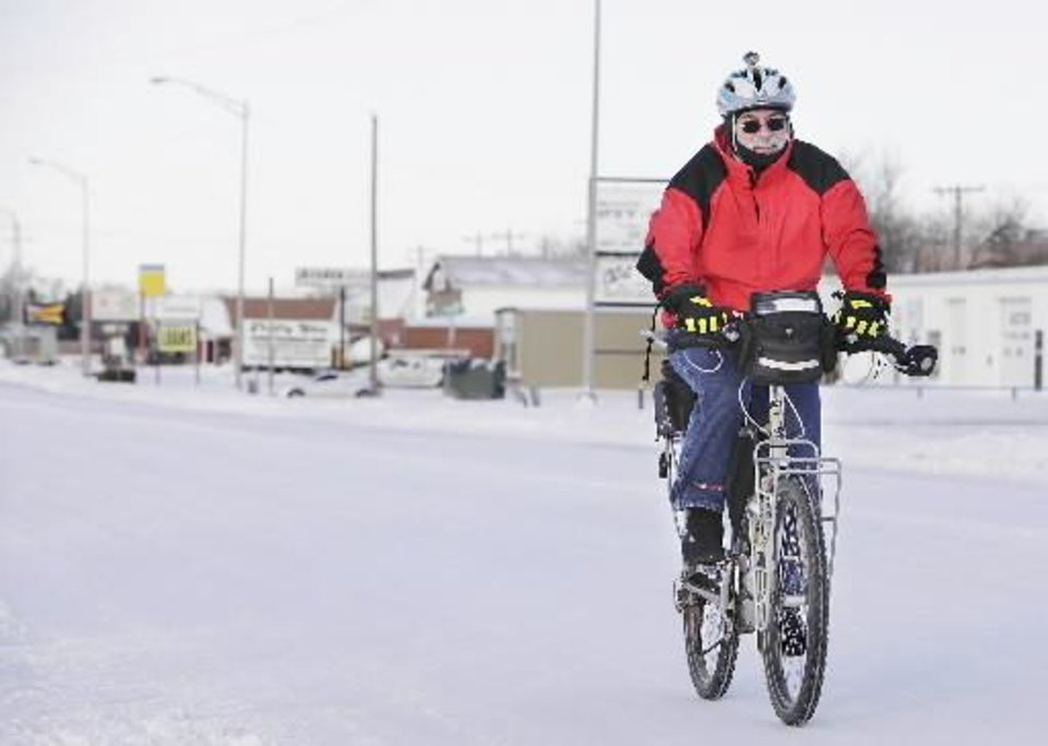 Photo - Kim Waggoner rides his bicycle to work every day even in the winter in Edmond, Wednesday, February 2, 2011. Photo by David McDaniel