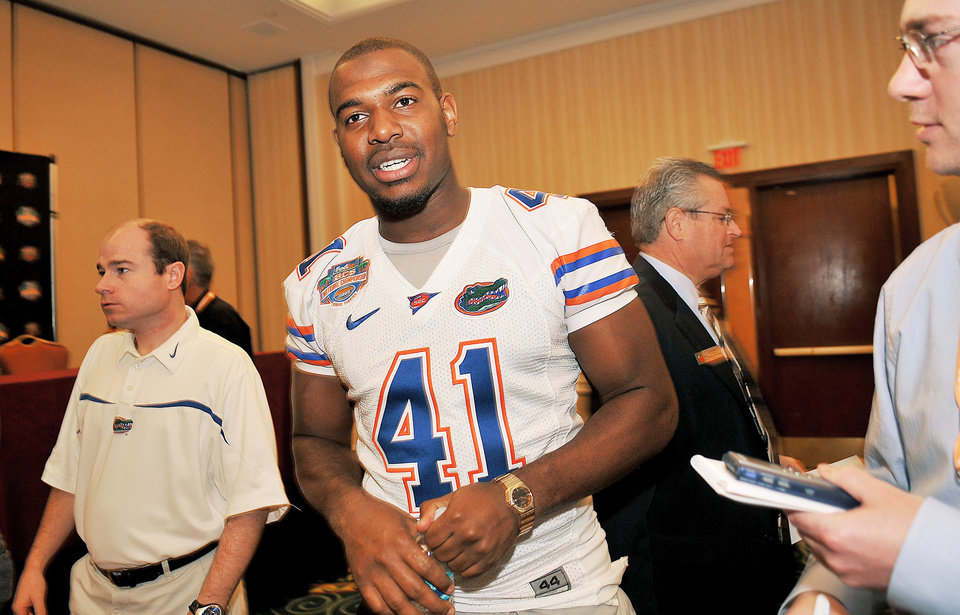 Photo - Florida linebacker Ryan Stamper answers questions Saturday. Stamper says one of the tough parts of dealing with the Sooner offense will be getting lined up on time.AP Photo