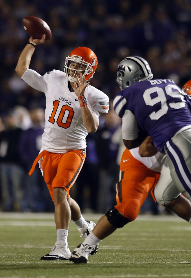 Photo - Oklahoma State's Clint Chelf (10) throws during the college football game between Kansas State University (KSU) and Oklahoma State (OSU) at  Bill Snyder Family Football Stadium in Manhattan, Kan.,  Saturday, Nov. 3, 2012. Photo by Sarah Phipps, The Oklahoman