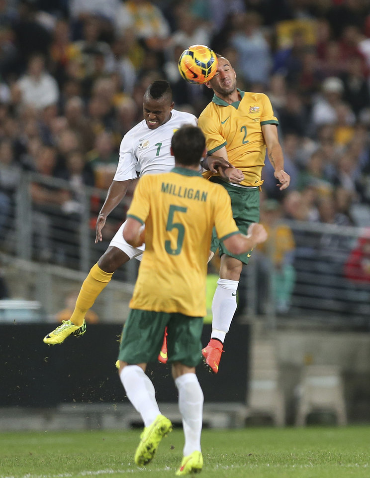 Photo - Australia's Ivan Franjic, right, and South Africa's Ayanda Patosi fight for the ball during their Soccer friendly match in Sydney, Australia, Monday, May 26, 2014. (AP Photo/Rob Griffith)