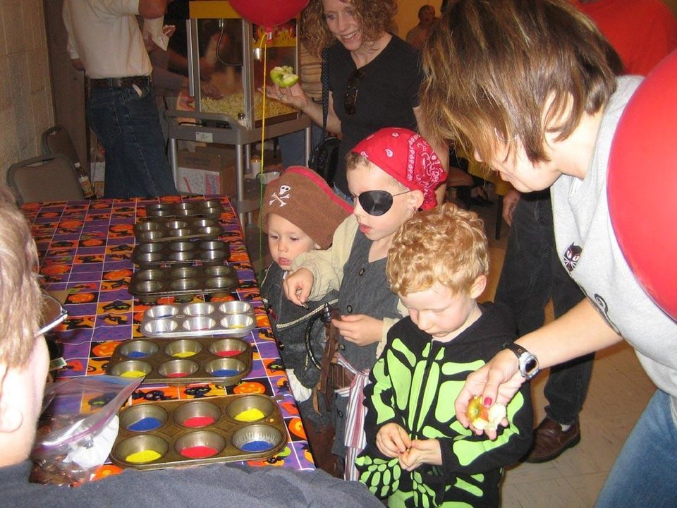 Zachary Connelly and mother, Kelly Connelly play the Penny Toss Game at the Family Fall Festival at First Christian Church in Guthrie.<br/><b>Community Photo By:</b> Sharon Johnston<br/><b>Submitted By:</b> Karen,