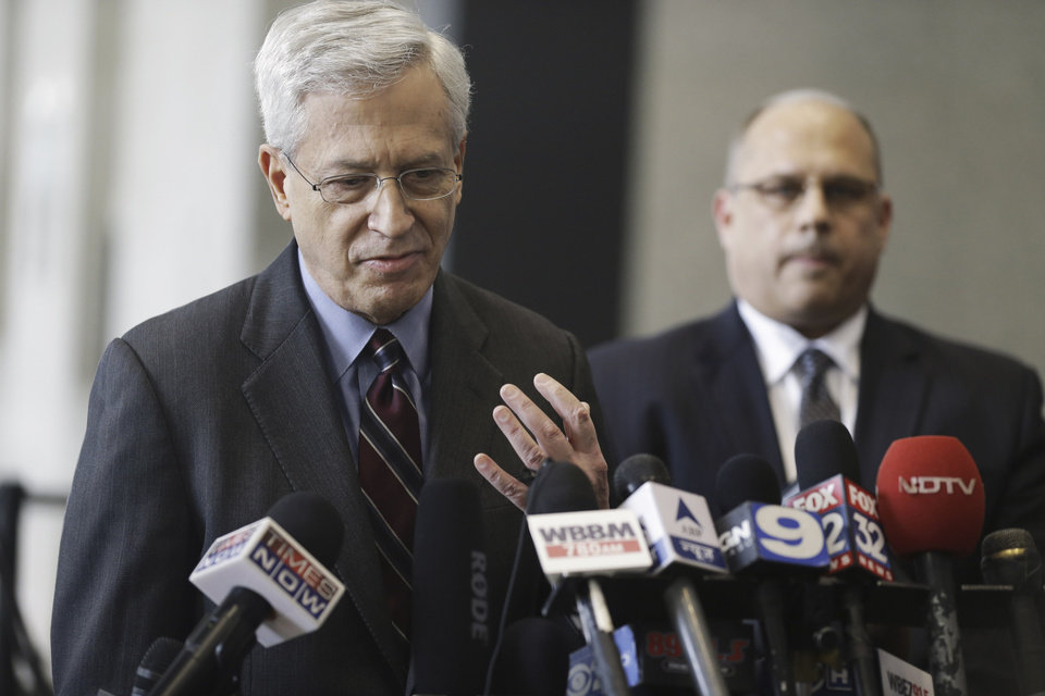 Photo - Acting U.S. Attorney Gary Shapiro speaks to reporters at the federal building in Chicago, Thursday, Jan. 24, 2013, after David Coleman Headley, 52, was sentenced to 35 years in prison for the key role he played in a 2008 terrorist attack on Mumbai that has been called India's 9/11. At right is Cory B. Nelson, special agent in charge of the FBI's Chicago office.  (AP Photo/M. Spencer Green)