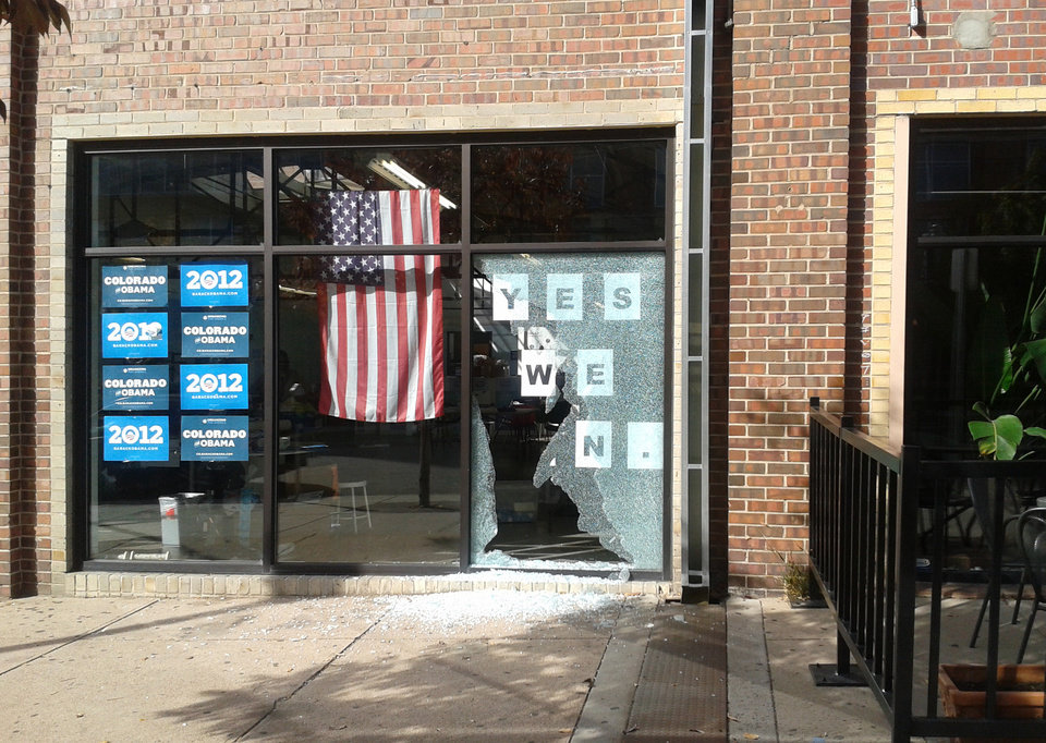 Photo -   This photo provided by Courtney Grimm shows the shattered glass outside of President Barack Obama's Denver campaign office on Friday, Oct. 12, 2012. Denver police say someone has fired a shot through the window of the campaign office. Police spokeswoman Raquel Lopez says people were inside the office when the shooting happened Friday afternoon, but no one was injured. A large panel of glass was left shattered at the office on West Ninth Avenue near Acoma Street. Lopez says investigators are looking at surveillance video but have not yet confirmed a description of a vehicle that might be linked to the shooting. Police didn't immediately release other details while detectives pursue leads. (AP Photo/Courtney Grimm)