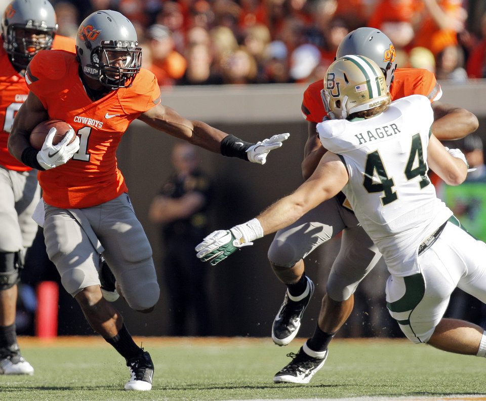 OSU's Joseph Randle (1) carries the ball as Tracy Moore (87) blocks Bryce Hager (44) of Baylor in the second quarter during a college football game between the Oklahoma State University Cowboys (OSU) and the Baylor University Bears (BU) at Boone Pickens Stadium in Stillwater, Okla., Saturday, Oct. 29, 2011. Photo by Nate Billings, The Oklahoman