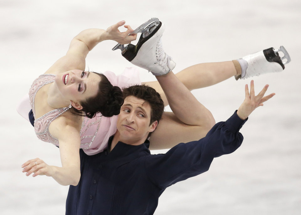 Photo - Tessa Virtue and Scott Moir of Canada compete in the ice dance free dance figure skating finals at the Iceberg Skating Palace during the 2014 Winter Olympics, Monday, Feb. 17, 2014, in Sochi, Russia. (AP Photo/Bernat Armangue)
