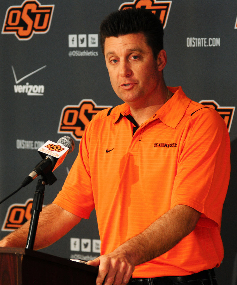 Oklahoma State coach Mike Gundy speaks to media members inside Boone Pickens Stadium at a scheduled media luncheon in Stillwater on Dec. 19, 2013. The Cowboys are preparing to play the Missouri Tigers in the AT&T Cotton Bowl Classic on January 3, 2014 in Dallas. Photo by KT King/For the Oklahoman <strong>KT King</strong>