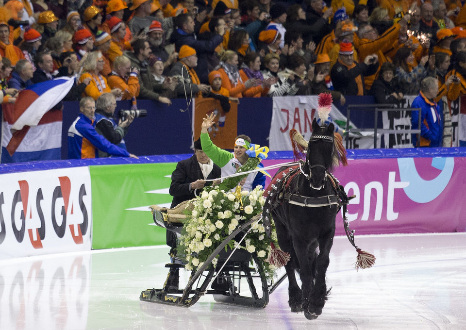 Photo - FILE - In this Jan. 13, 2013, file photo, new European champion Sven Kramer, of the Netherlands, rides a lap of honor in a horse-pulled sled after winning the allround European speedskating championship at Thialf stadium in Heerenveen, northern Netherlands. Time and again over the last half century, the Dutch are top or near the top of the speedskating standings at any Olympic and for a nation of 16.8 million, it often defies giants like the United States, Russia or Germany. This time too, the Dutch have a realistic chance for a half dozen gold medals on the big oval. (AP Photo/Peter Dejong, File)