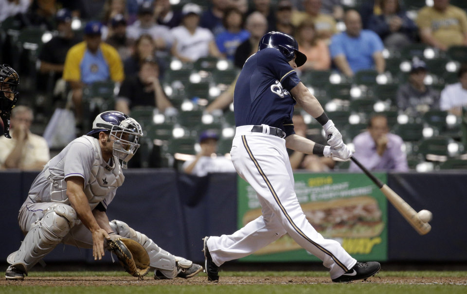 Photo - Milwaukee Brewers' Scooter Gennett hits a two-run home run during the eighth inning of a baseball game against the Colorado Rockies on Thursday, June 26, 2014, in Milwaukee. (AP Photo/Morry Gash)