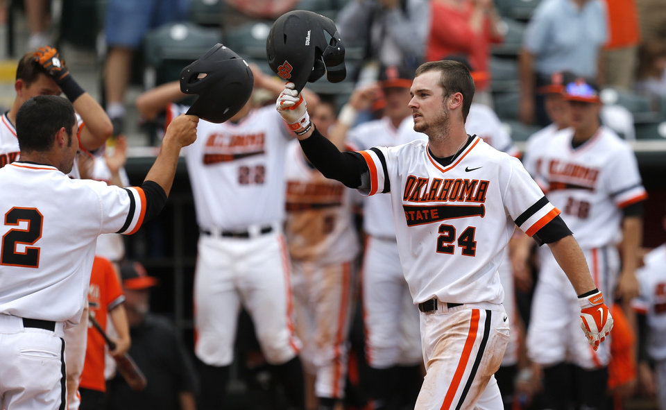 OSU's Conor Costello celebrates after scoring on a two-run home run in the second inning during a Big 12 Tournament baseball game between Oklahoma State University and the University of Texas at Chickasaw Bricktown Ballpark in Oklahoma City, Saturday, May 24, 2014. Photo by Bryan Terry The Oklahoman