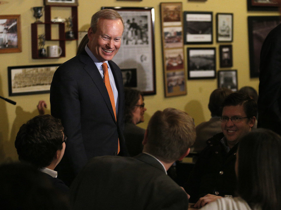 Photo -  Mayor Mick Cornett talks with supporters Tuesday at his mayoral race watch party in Oklahoma City. Photo by Sarah Phipps, The Oklahoman   SARAH PHIPPS -