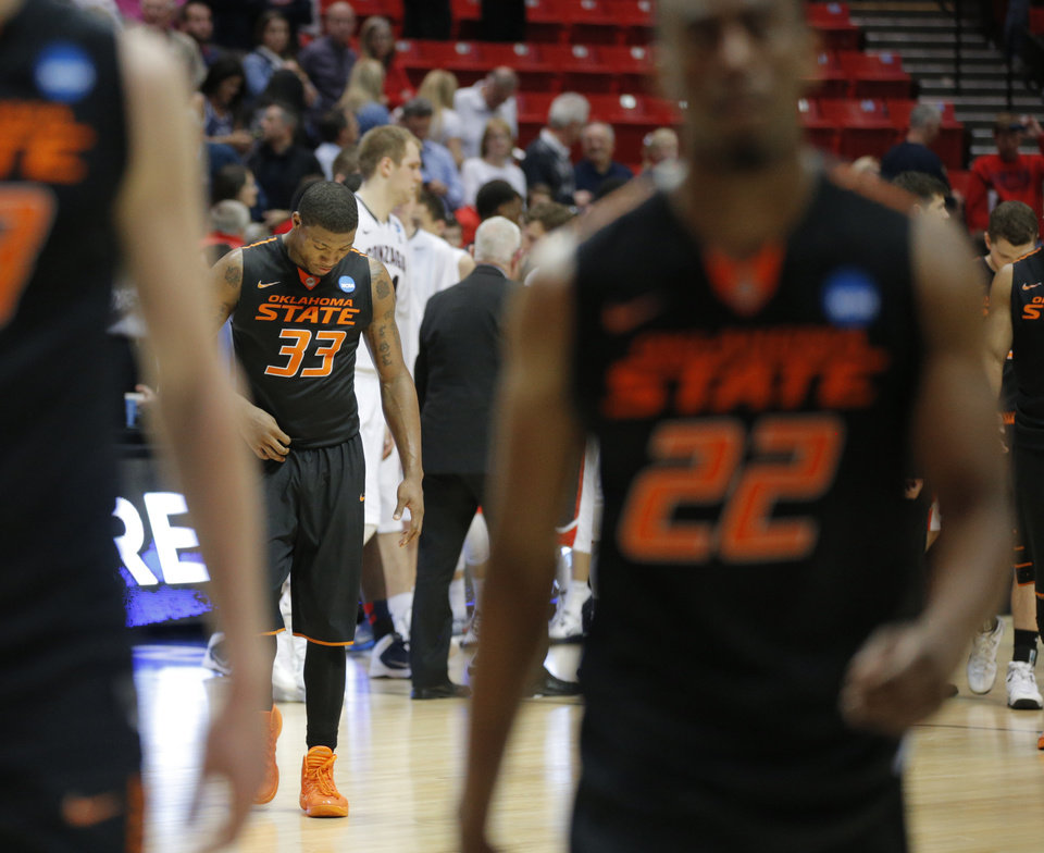 Photo - Oklahoma State's Marcus Smart (33) walks off the court after losing a second round game of the NCAA men's college basketball tournament at Viejas Arena in San Diego, between Oklahoma State and Gonzaga Friday, March 21, 2014. Gonzaga won 85-77. Photo by Bryan Terry, The Oklahoman
