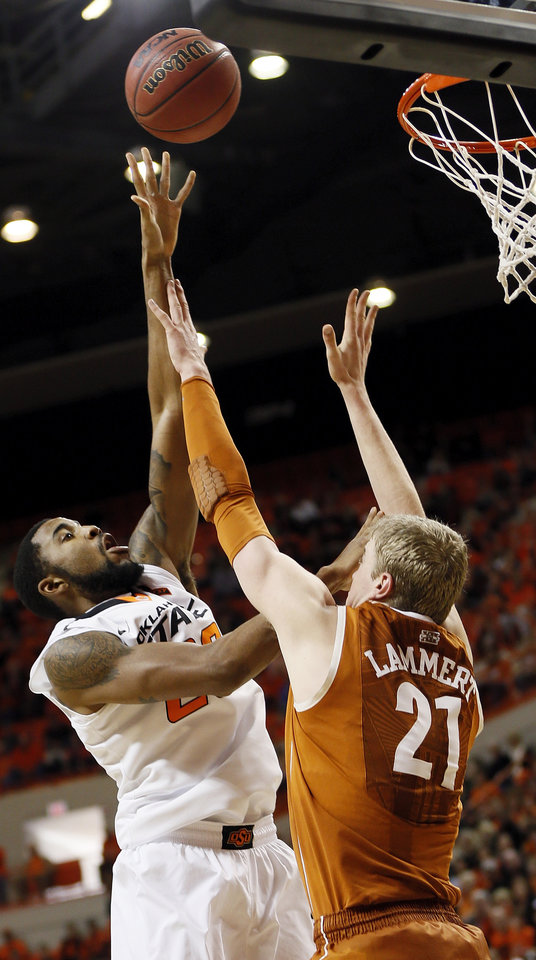 Photo - Oklahoma State's Michael Cobbins (20) shoots against Texas' Connor Lammert (21) during a men's college basketball game between Oklahoma State University (OSU) and the University of Texas at Gallagher-Iba Arena in Stillwater, Okla., Saturday, March 2, 2013. OSU won, 78-65. Photo by Nate Billings, The Oklahoman