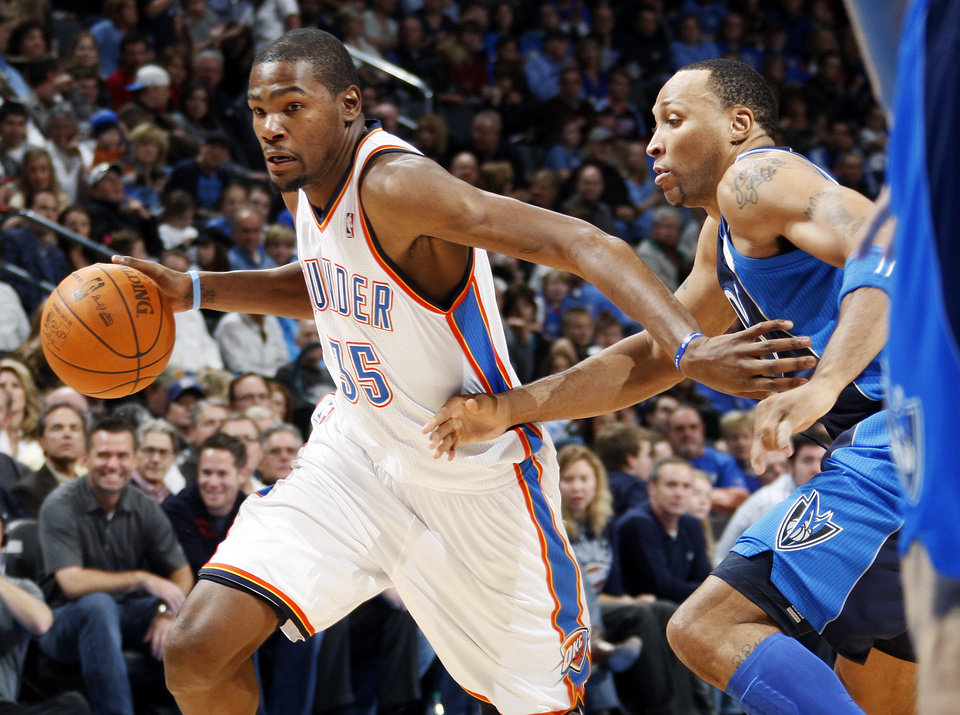 Photo - Oklahoma City's Kevin Durant (35) drives the ball past Shawn Marion (0) of Dallas in the first half during an NBA basketball game between the Oklahoma City Thunder and the Dallas Mavericks at Chesapeake Energy Arena in Oklahoma City, Thursday, Dec. 29, 2011. Photo by Nate Billings, The Oklahoman