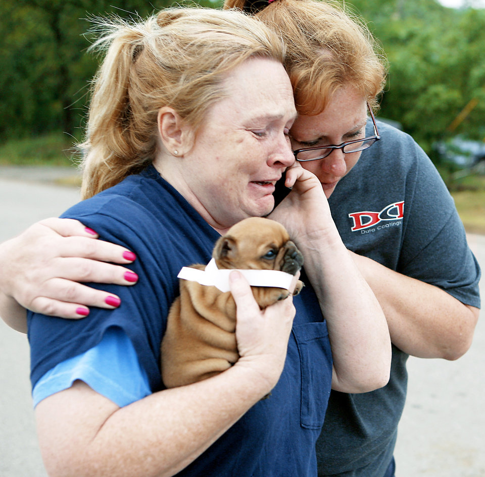 Shelley Heston Bolles, left, and Gidget Miller react Tuesday as they celebrate finding a 4-week-old puppy that belongs to Heston Bolles in Little Axe.  PHOTO BY By John Clanton, The Oklahoman