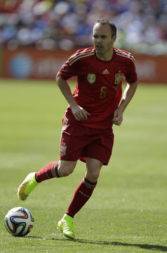 Photo - In this June 7, 2014 photo, Spain's Andres Iniesta wears his Nike Magista cleats during an exhibition soccer game against El Salvador in Landover, Md. The competition on the pitch in has yet to start, but the fight over World Cup consumers is already intense _ and no more so than between the athletic companies that are jockeying for their once-every-four-years shot at the ever-growing soccer market(AP Photo/Luis M. Alvarez)