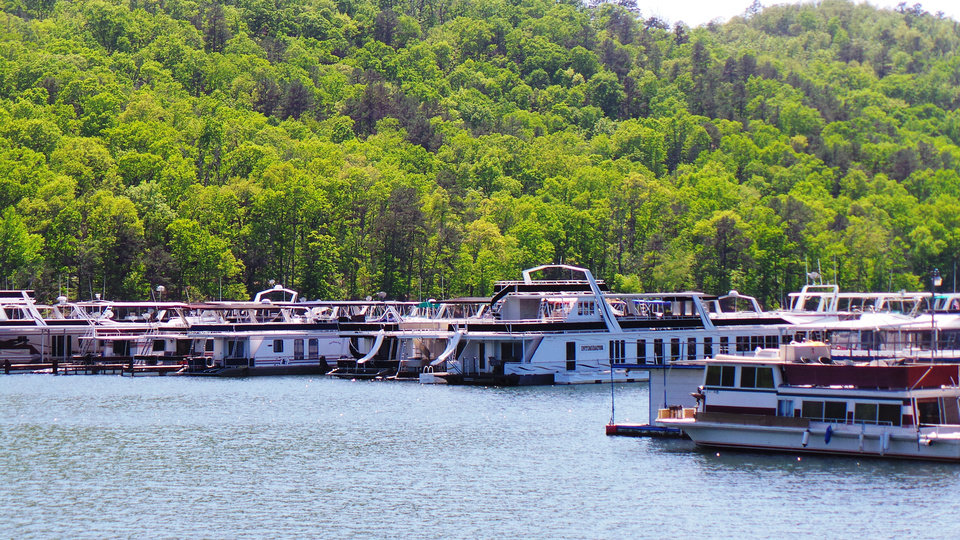 Photo - House boats are docked at the Beavers Bend Marina on Broken Bow Lake. PHOTO BY LILLIE-BETH BRINKMAN, THE OKLAHOMAN