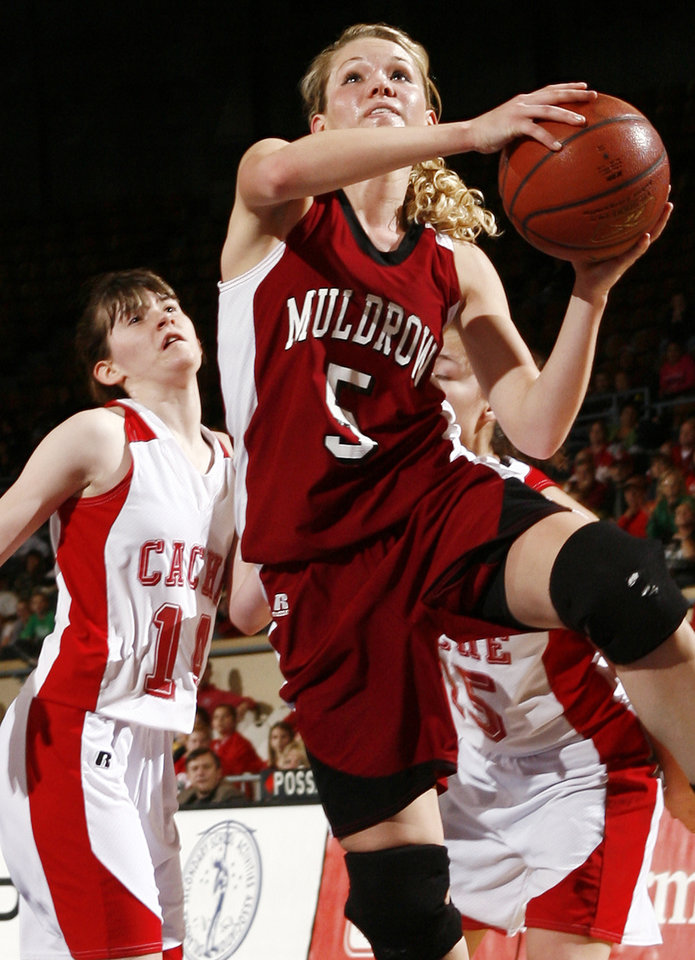 Photo - Muldrow's Sarah Martin (5) shoots the ball in front of Cache's Lindsey Carter (14) during 4A girls semifinal game between Muldrow and Cache in the Oklahoma High School Basketball Championships at State Fair Arena in Oklahoma City, Friday, March 13, 2009. PHOTO BY NATE BILLINGS, THE OKLAHOMAN