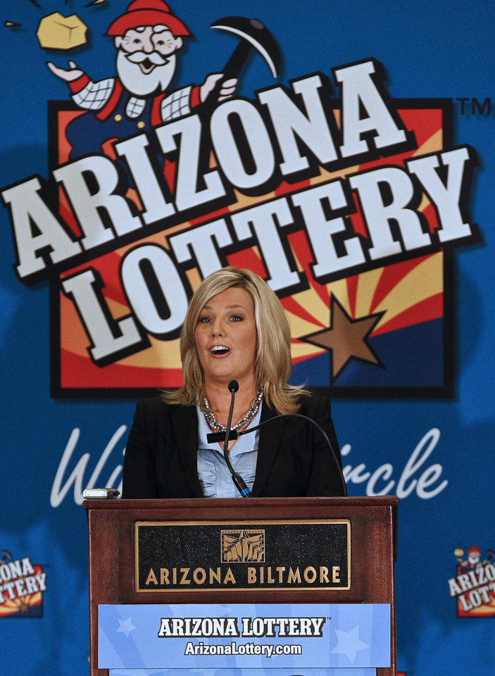 Photo - Karen Bach, Director of Budget, Products and Communications of the Arizona Lottery, announces during a news conference that one of the winning tickets in the $579.9 million Powerball jackpot was purchased in Fountain Hills, Ariz., Thursday, Nov. 29, 2012, in Phoenix.(AP Photo/Ross D. Franklin)