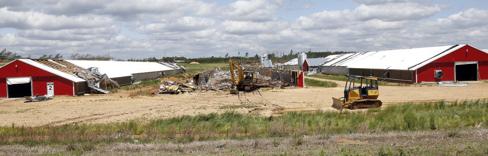 Photo - Chicken houses remain on both sides of one that was flattened at Pine Ridge Farm  by a tornado Monday in Noxapater, Miss., as seen in this photograph taken Wednesday, April 30, 2014. Several poultry farms were damaged by a tornado on Monday.  (AP Photo/Rogelio V. Solis)