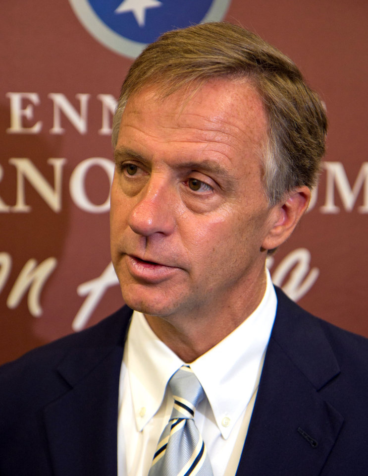 Photo - File-This June 21, 2011, file photo shows Republican Gov. Bill Haslam speaking to reporters after a speech at Lipscomb University in Nashville, Tenn. Authorities say the truck-stop company owned by Cleveland Browns owner Jimmy Haslam and Tennessee Gov. Bill Haslam has agreed to pay $92 million in fines for cheating customers out of promised rebates and discounts. The agreement was signed by attorneys for the nation's largest diesel retailer Friday. The agreement does not protect any individual at Pilot from prosecution and requires the company to cooperate with an ongoing investigation of current and former employees. Jimmy Haslam has said he was unaware of the scheme. Tenn. Gov. Bill Haslam is not involved in Pilot's day-to-day operations.  (AP Photo/Erik Schelzig, File)