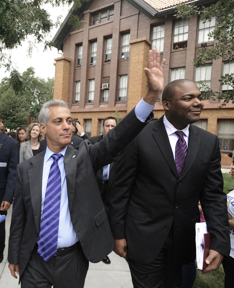 Photo -   FILE - In this Sept. 9, 2011 file photo, Chicago Mayor Rahm Emanuel, left, and Chicago Public Schools CEO Jean-Claude Brizard greet students as they arrive at Carl Schurz High School in Chicago. On Thursday, Oct. 11, 2012, Brizard stepped down from the post by mutual agreement after a little more than a year in the post. The move comes about three weeks after CPS and the Chicago Teachers Union resolved the first teachers strike in the city in a quarter century. Emanuel named Brizard to the post 17 months ago. (AP Photo/Paul Beaty, File)