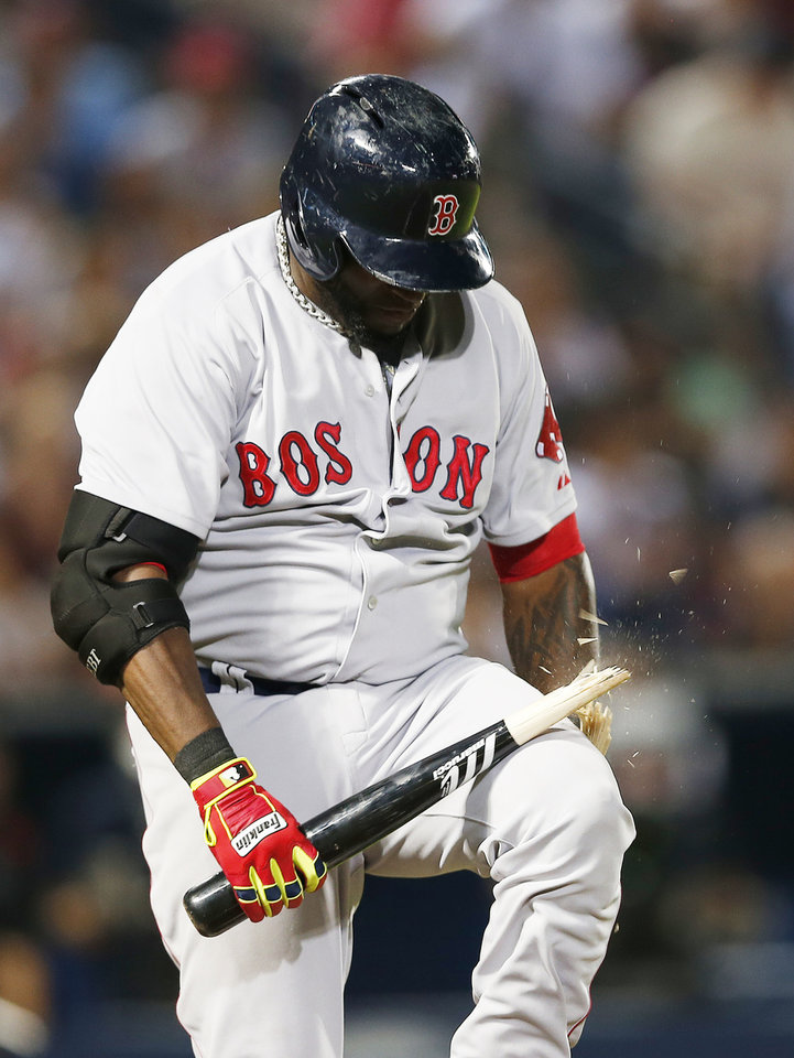 Photo - Boston Red Sox' David Ortiz breaks his bat over his knee after grounding out to end Boston's half of the eighth inning of a baseball game against Atlanta Braves on Tuesday, May 27, 2014, in Atlanta. (AP Photo/John Bazemore)