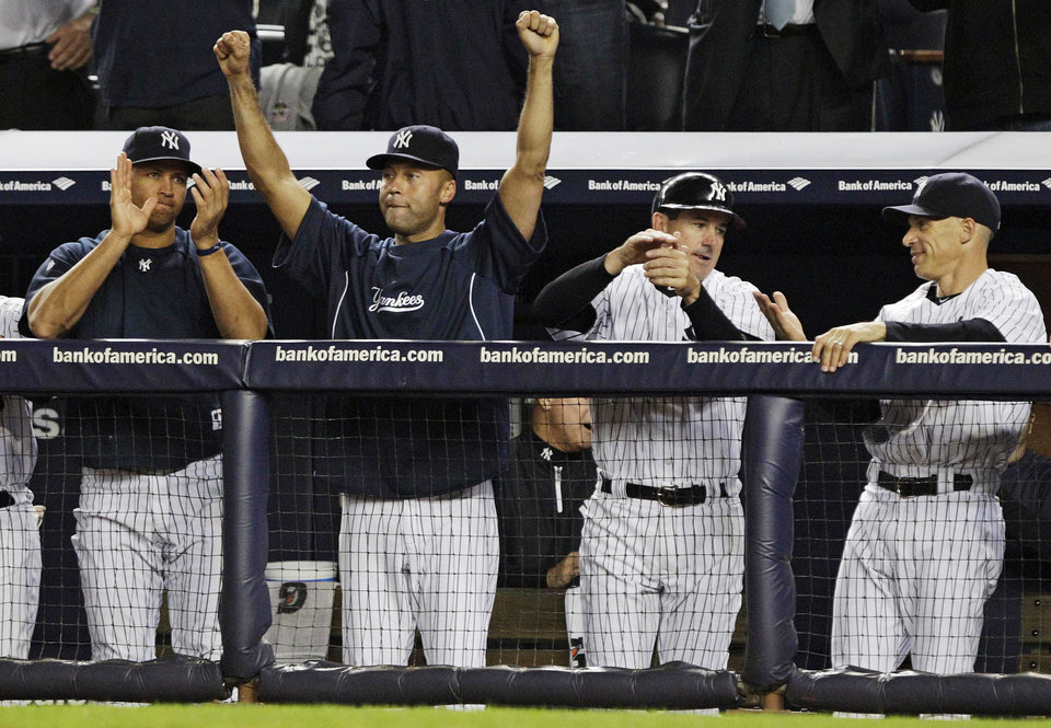 Photo -   New York Yankees' Alex Rodriguez, left, Derek Jeter, second from left, and manager Joe Girardi, right, celebrate their 14-2 win over the Boston Red Sox in a baseball game, Wednesday, Oct. 3, 2012, in New York. The Yankees clinched the American League East title. (AP Photo/Frank Franklin II)