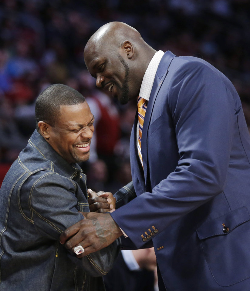 Actor and comedian Chris Tucker, left and former NBA basketball player Shaquille O'Neal laugh during NBA All-Star Saturday Night, Feb. 16, 2013, in Houston. (AP Photo/Eric Gay)