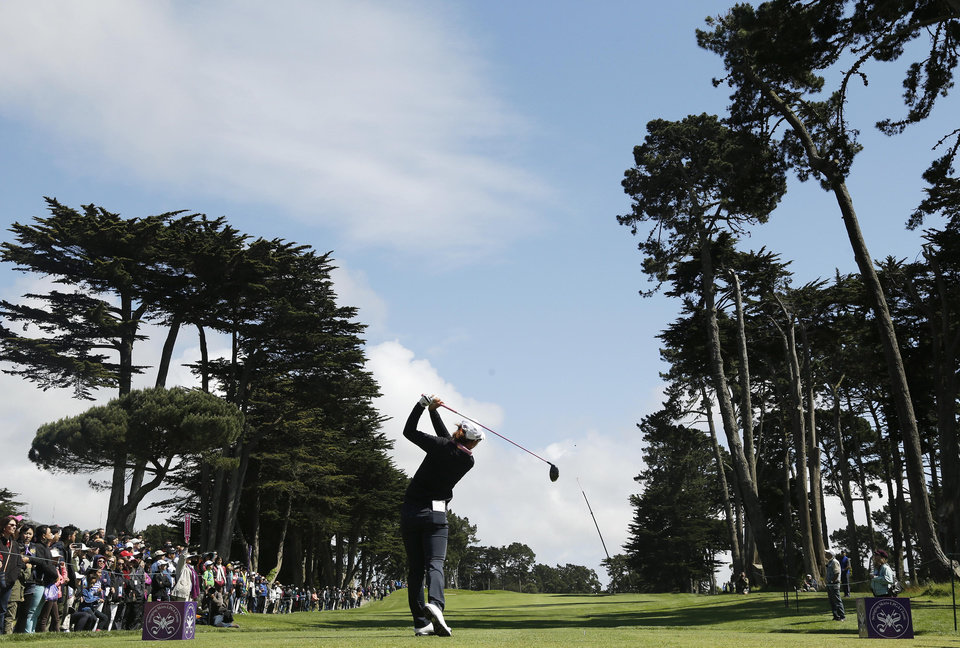 Photo - Lydia Ko, of New Zealand, follows her drive from the sixth tee of Lake Merced Golf Club during the final round of the Swinging Skirts LPGA Classic golf tournament on Sunday, April 27, 2014, in Daly City, Calif. (AP Photo/Eric Risberg)