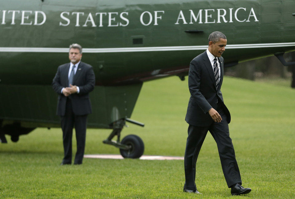 <p>President Barack Obama returns to the White House on the Marine One helicopter, after visiting Superstorm Sandy affected areas of New York, in Washington on Thursday, Nov. 15, 2012. (AP Photo/Jacquelyn Martin)</p>