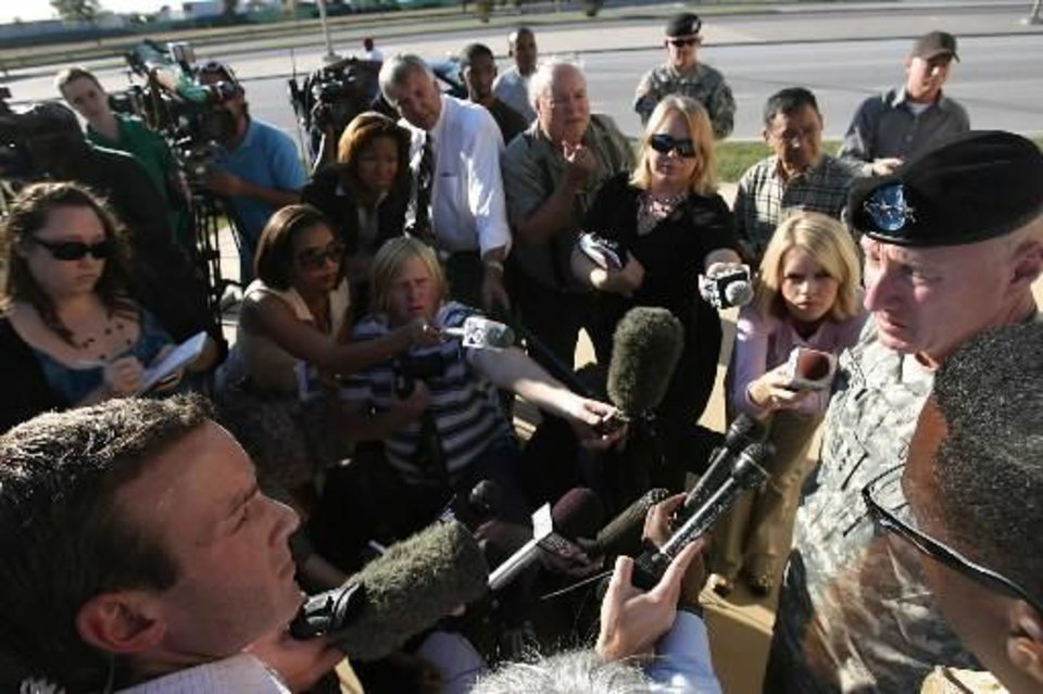 Photo - Army Lt. Gen. Robert Cone gives a news conference after a shooting in  Fort  Hood, Texas on Thursday, Nov. 5, 2009. (AP Photo/Austin American-Statesman, Rodolfo Gonzalez)