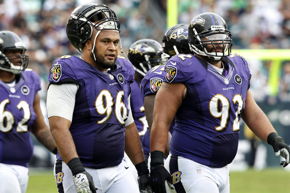 Photo -   FILE - In this Sept. 16, 2012, file photo, Baltimore Ravens nose tackle Maake Kemoeatu (96) walks with defensive end Haloti Ngata (92) and nose tackle Terrence Cody (62) late in the second half of an NFL football game against the Philadelphia Eagles in Philadelphia. The NFL's new form-fitting uniforms made by Nike are a big hit, especially among players with sculpted physiques. But for those players who don't have the Adonis-like physiques, the shrink-wrap fit of the new lightweight, body-contoured uniforms don't look so flattering. (AP Photo/Mel Evans, File)