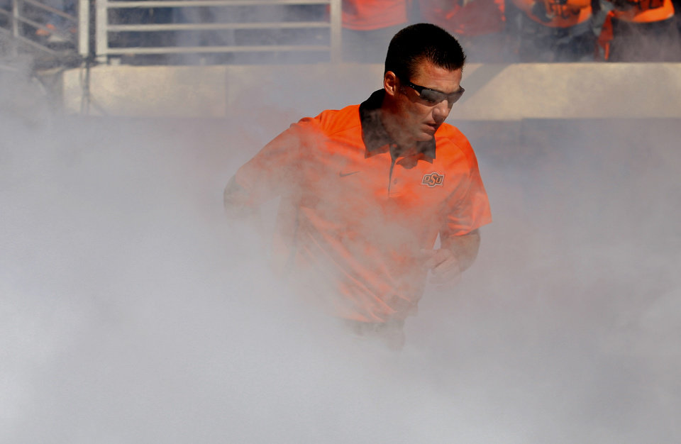 Oklahoma State head coach Mike Gundy runs on to the field before a college football game between Oklahoma State University (OSU) and Iowa State University (ISU) at Boone Pickens Stadium in Stillwater, Okla., Saturday, Oct. 20, 2012. Photo by Sarah Phipps, The Oklahoman