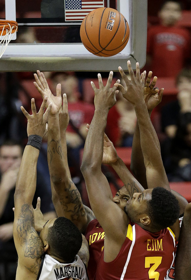 Photo -   UNLV's Anthony Marshall, left, battles for a rebound against Iowa State's Melvin Ejim in the second half of an NCAA college basketball game, Saturday, Nov. 24, 2012, in Las Vegas. UNLV won 82-70. (AP Photo/Julie Jacobson)