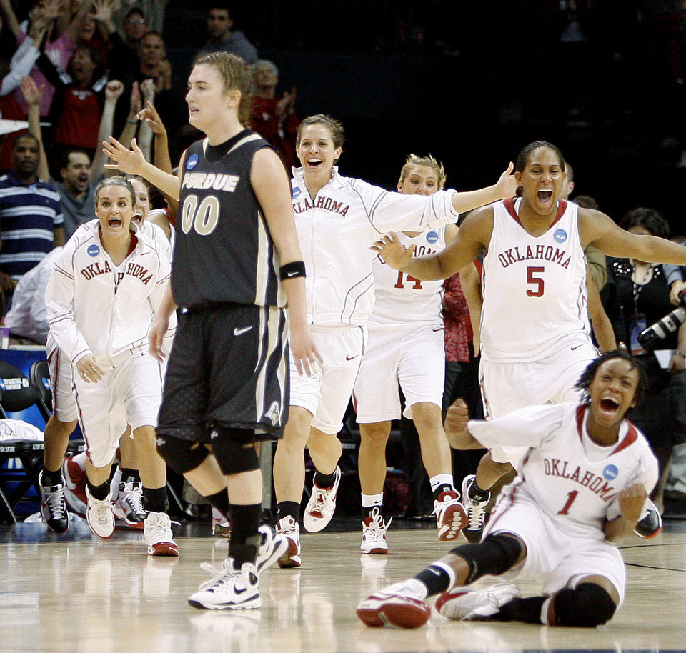 Photo - The OU bench takes the floor as Purdue's Jodi Howell leaves the court after OU's win in the NCAA women's basketball regional  tournament finals between Oklahoma and Purdue at the Ford Center in Oklahoma City, Tuesday, March 31, 2009.  Photo by Bryan Terry, The Oklahoman