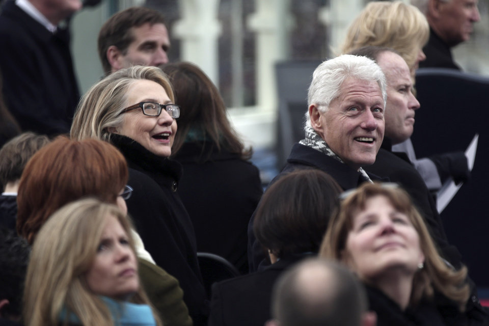Photo - Secretary of State Hillary Rodham Clinton and former president Bill Clinton look on during the ceremonial swearing-in ceremony during the 57th President Inauguration, Monday, Jan. 21, 2013, on the West Front of the Capitol in Washington.  (AP Photo/Win McNamee, Pool)