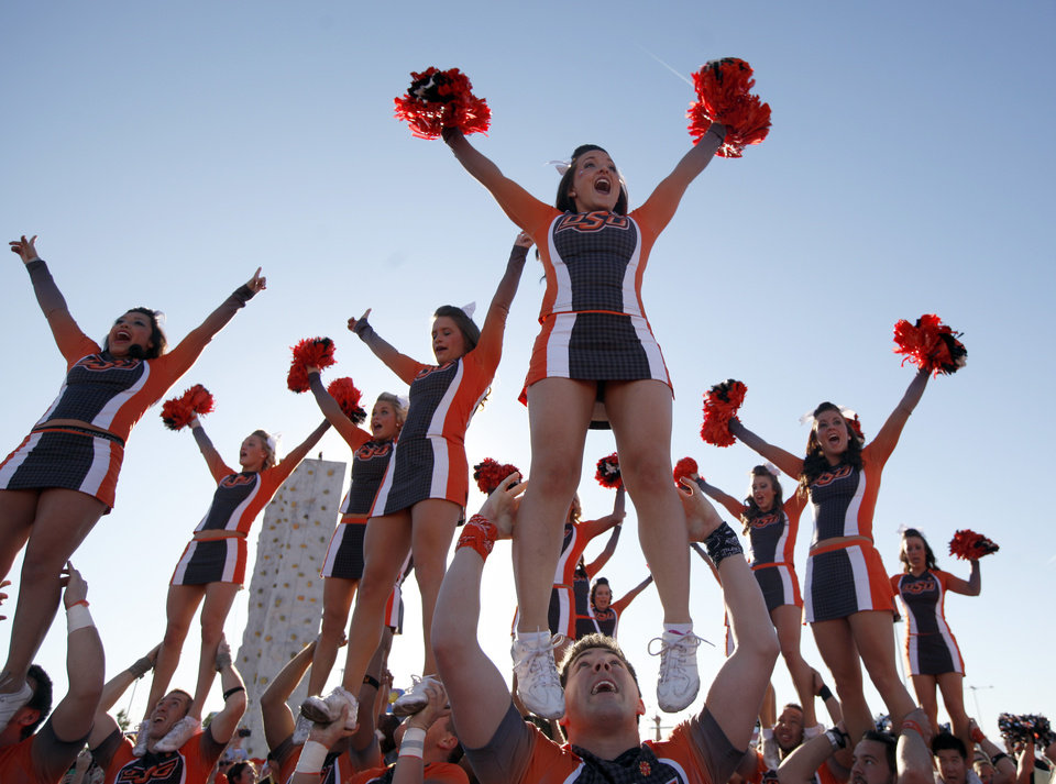 Photo - Cheerleaders entertain fans before  the Fiesta Bowl between the Oklahoma State University Cowboys (OSU) and the Stanford Cardinal at the University of Phoenix Stadium in Glendale, Ariz., Monday, Jan. 2, 2012. Photo by Sarah Phipps, The Oklahoman