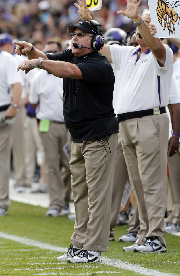 Photo - TCU head coach Gary Patterson gives instructions to his team during the college football game between the University of Oklahoma Sooners (OU) and the Texas Christian University Horned Frogs (TCU) at Amon G. Carter Stadium in Fort Worth, Texas, on Saturday, Dec. 1, 2012. Photo by Steve Sisney, The Oklahoman