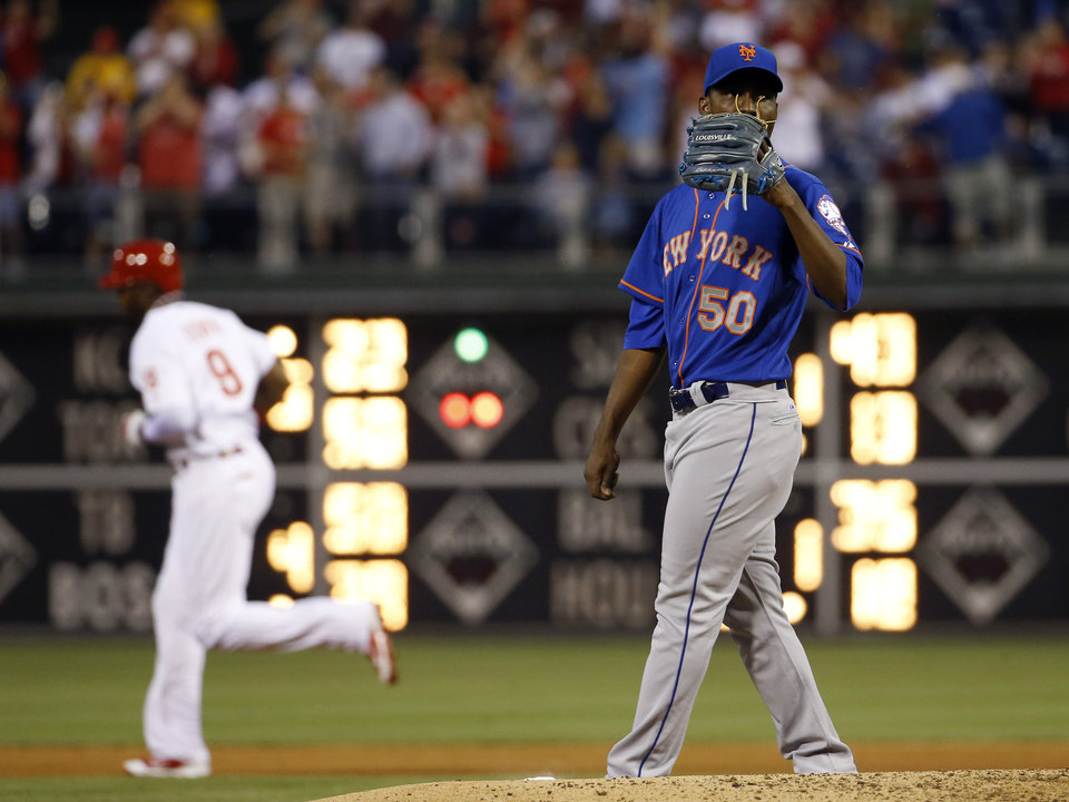 Photo - New York Mets starting pitcher Rafael Montero, right, wipes his face after giving up a three-run home run to Philadelphia Phillies' Domonic Brown during the fourth inning of a baseball game, Friday, May 30, 2014, in Philadelphia. (AP Photo/Matt Slocum)