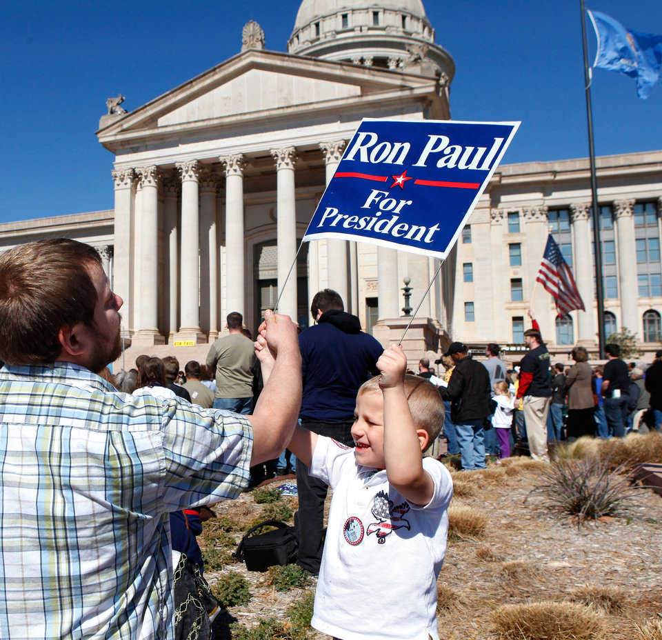 Photo - Noah Gosney, 5, gets help with a sign from his dad, James Gosney, who brought Noah and his brother to the rally. Photo by Jim Beckel, The Oklahoman
